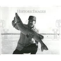 1970 Press Photo Man Catches Huge Pike Ice Fishing