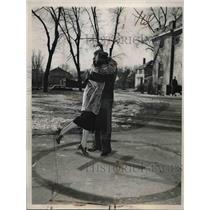 1937 Press Photo Female gets a kiss, Red X and Circle, Municipal University