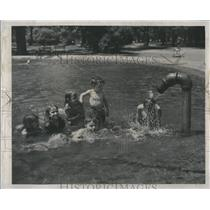 1947 Press Photo Kids swimming in pond at Clark Park. - RRS27917