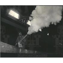 1964 Press Photo bug spray fills the air