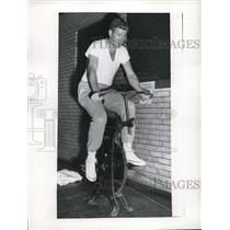 1957 Press Photo Herb Score of Cleveland Indians Working Out on Bicycle