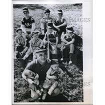 1958 Press Photo Raymond Sweeney and his baby son of Wis.,and his Rangers Team.