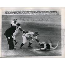 1957 Press Photo Jerry Schoonman Senators Tagged Out At 2nd By Marv Blaylock MLB