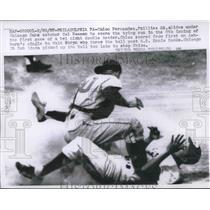 1957 Press Photo Phillies Chico Fernandez Slides Under Cubs Cal Neeman to Score