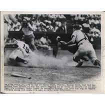 1948 Press Photo George Kell, Detroit third baseman, slides in safe at home