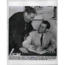 1955 Press Photo Phillies Pitcher Robbin Roberts signed his 1955 Contract.