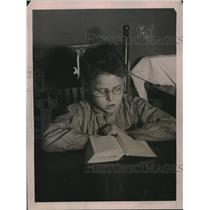 1921 Press Photo Francis Edward Faulkner Child Reading With Special Glasses
