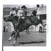 1960 Press Photo Bud Palmer on a bronco at Natl Finals Rodeo