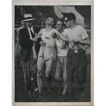 1941 Press Photo Joe McCluskey Collapses, 100 Yard Relay, AAU Meet, Philadelphia