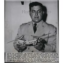 1957 Press Photo Maj Jones P. Seigler shown with helicopter like he flew to
