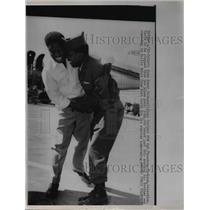 1963 Press Photo John Henry Jackson hugs Vietnam POW brother Cpl Theodore in Tx