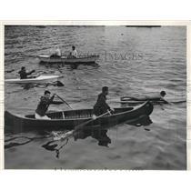 1936 Press Photo People using kay, canoe, a paddleboard and a row-boat.