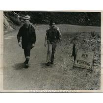 1938 Press Photo Russell Moore and George Joubin, trudge up a mountain.