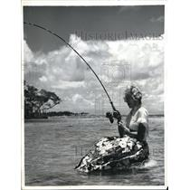 1957 Press Photo Pretty Fishing Woman Loses Her Balance and Gets Wet