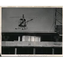 1963 Press Photo helicopter landing on apt. bldg in Cleveland