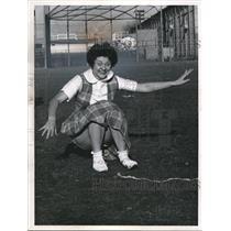 1961 Press Photo Collinwood High cheerleader land after summersaulting cheer
