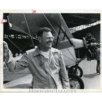 1976 Press Photo Buck Hilbert and his vintage swallow Airplane