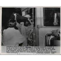 1955 Press Photo Diver Bill Troy Pulled from Tank, Underwater Endurance Attempt