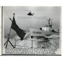 1953 Press Photo Coast Guard Helicopter hovering at Coast Guard Patrol Vessel.