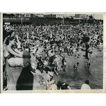1936 Press Photo Australians enjoying a torrid mid-summer sun and sun bathing