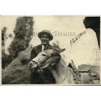 1922 Press Photo Lewis Jokingly Puts Burro in Head-Lock While in Colorado Spring