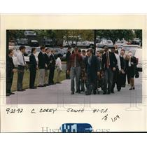 1992 Press Photo off to Corey Fay's memorial mass as classmate held roses