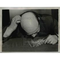 1937 Press Photo Man Playing Pick Up Stix - nee00033