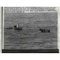 1960 Press Photo 2 girls rescued from overturned boat on Charles River, Boston