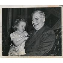 1950 Press Photo A Governor holding a small girl
