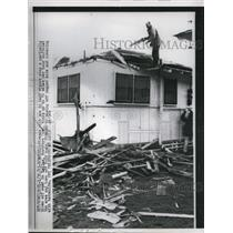 1963 Press Photo Fireman atop a partially blown off roof in Kailna, Northern, Oh