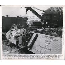 1950 Press Photo Salvage workers remove sacks of products after the accident