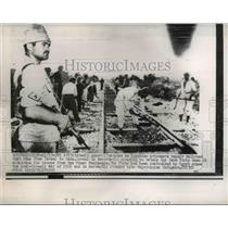 1956 Press Photo Israel guard watches as Egyptian prisoners repair a railroad.