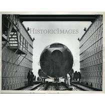 1962 Press Photo of a plane in an water tank test chamber. - nee18048