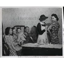 "1943 Press Photo A public health nurse provides a ""shots"" for anti-typhoid"