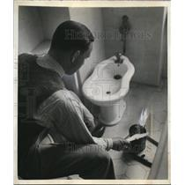 1942 Press Photo Joseph W Grigg Berlin Bureau Manager United Press Burning Paper