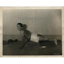 1925 Photo silent film actress Pauline Starke working to stay shape