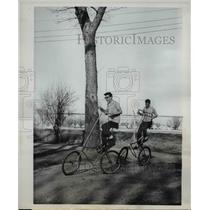 1963 Press Photo Douglas Schiller and Dennis Oostdik ride the high cycle