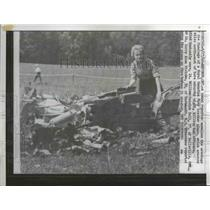 1962 Press Photo The reporter examines the wreckage of the fuselage