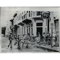 1961 Press Photo Dominican Police Storm Buildings They Arrested 50 People