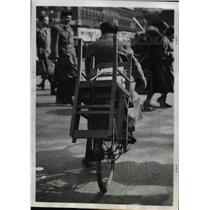 1952 Press Photo Paris Bicyclist Carries a Chair on his Bike - nee36511