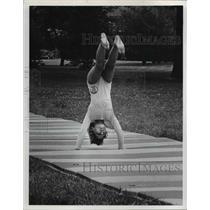 1974 Press Photo Girl flips during gymnastics routine - nee40067