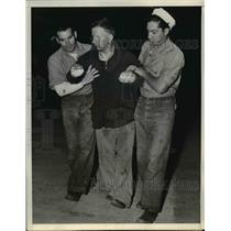 1937 Press Photo of Milton Conham being helped by two Coast Guardsmen.