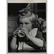 1949 Press Photo Little girl enjoys first glass of milk since Berlin Blockade
