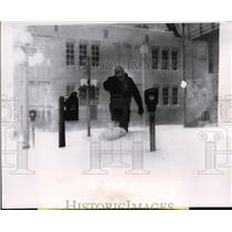 1957 Press Photo of man trudging through the snow in Amarillo, Texas.