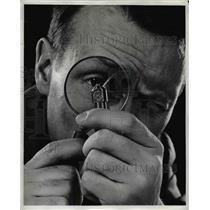 1955 Press Photo Dr. H. Tracy Hall Examining A Diamond Tool with titanium bond