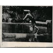 1939 Press Photo Longview Wash Betty Berkley handsprings on a floating log