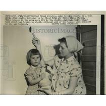 1958 Press Photo Mrs John Novotny Points to Hole She Believes AF Plane Fire Made