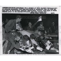 1957 Press Photo Youngsters lean over rail at Busch Stadium to get autographs