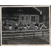 1940 Press Photo Annual Penn races 400 meter hurdles Gil Farrow, John Scales