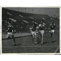 1939 Press Photo Erwin Miller USC wins 440 yard dash vs Don Watts, Robert Simmon